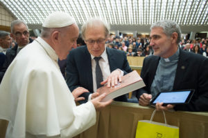 EDITORIAL USE ONLY. NOT FOR SALE FOR MARKETING OR ADVERTISING CAMPAIGNS. January 4, 2017: Georges SANEROT, president of Bayard Presse gives Pope Francis a copy of the Bible during the general audience in Paul VI Hall at the Vatican. &#8226Creation Date: 01/04/2017 &#8226 Reference: 339018 &#8226 Library: CIRIC International &#8226 Signature: ServizioFotograficoOR/CPP/CIRIC