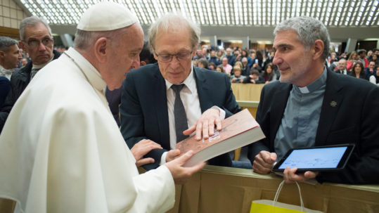 EDITORIAL USE ONLY. NOT FOR SALE FOR MARKETING OR ADVERTISING CAMPAIGNS. January 4, 2017: Georges SANEROT, president of Bayard Presse gives Pope Francis a copy of the Bible during the general audience in Paul VI Hall at the Vatican. &#8226	Creation Date: 01/04/2017 &#8226	Reference: 339018 &#8226	Library: CIRIC International &#8226	Signature: ServizioFotograficoOR/CPP/CIRIC